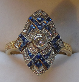 Gem quality sapphires set in sapphire and diamond art deco style ring