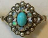 cabochon cut turquoise lady's ring set with opals and pearls in 9ct yellow gold