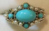 cabochon cut turquoise cut ring set with pearls