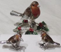 (Shown in photo above: Silver enamel robin perched on a holly branch. Silver enamelled robin cufflinks)